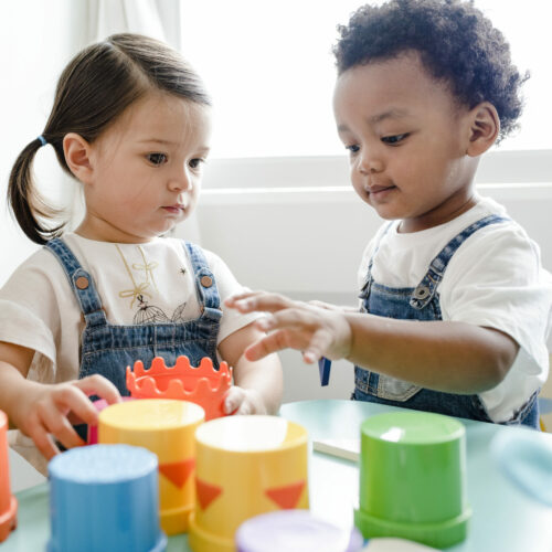 Two toddlers playing while in child care.