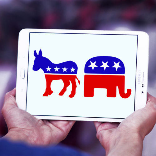 Picture of donkey and elephant on a tablet, representing the Democrat and Republican parties.