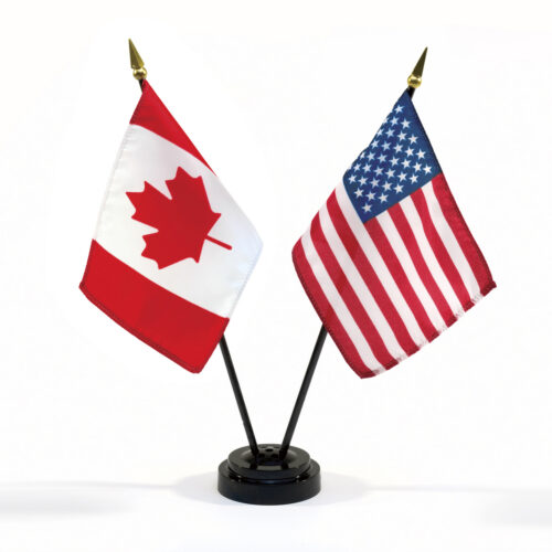 Flags of Canada and the United States of America next to one another.
