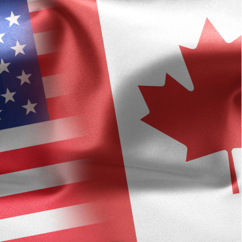 United States and Canada flags mixing.