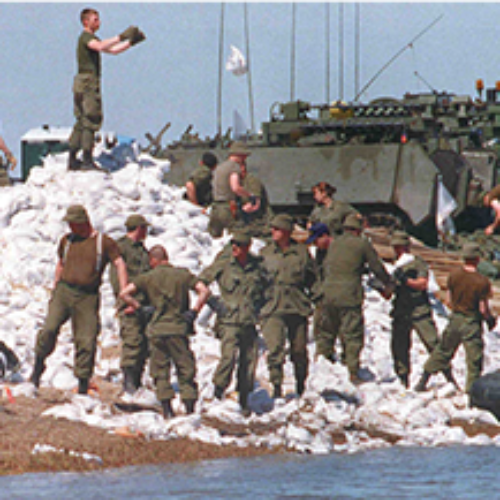 Photo of soldiers tossing sandbags during a historic flood that hit Manitoba in 1997.
