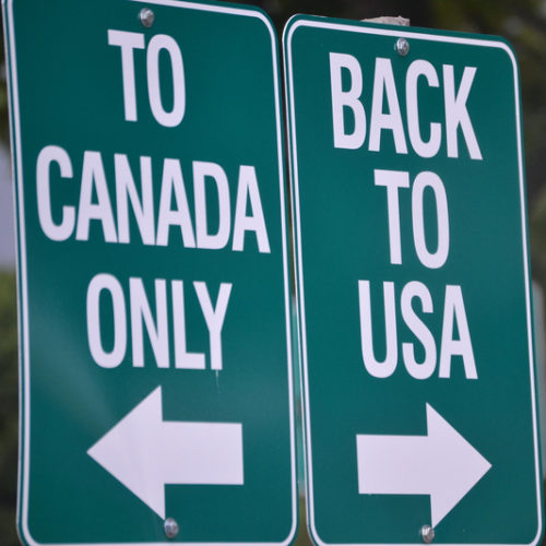 Road signs saying to Canada only in one direction and back to USA in the other direction.