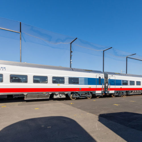 """Exterior view of new """"Amtrak Midwest"""" passenger car"""
